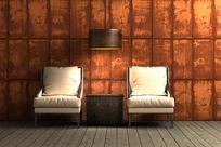 Two white loveseats sitting to the left and right of a wooden hanging lamp and small box all sit in front of a large antique Infused Veneer Panel decorated wall.