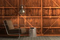 A brown loveseat, metal hanging lamp, and metal stool sit in front of a large Infused Veneer paneled wall with the decorations making it seem like shelves are running horizontally and vertically across.
