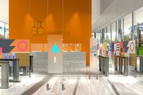Various frosted glass panels with colorful designs and words printed on them are hung with cables and rods are placed within an office space. A large orange wall stands in the background with the Universital LLC logo and title printed on it.