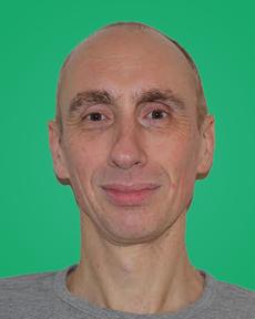 Pieter Van Driessche in front of green background
