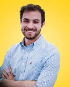 Gianni Noulez de Miguel in front of a yellow background