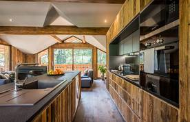 Wooden open kitchen with mountains views at Moulin I luxury chalet in Les Gets