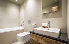 Beige and wooden modern bathroom with bathtub
