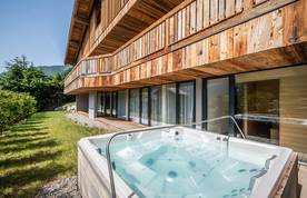 Outdoor hot tub at Le Rouge luxury chalet in Morzine