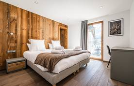 Double bedroom ensuite with wooden walls at Ruby luxury accommodation in Chamonix