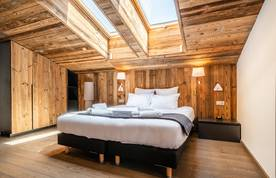 Double bedroom with roof windows at Le Rouge luxury chalet in Morzine