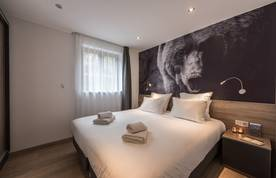 Double bedroom with bear photography at Lovoa accommodation in Morzine