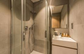Grey bathroom with shower at Iroko accommodation in Morzine