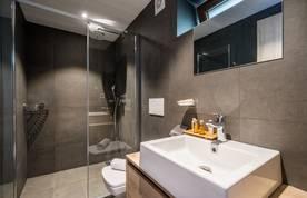 Dark grey bathroom with shower at Karri accommodation in Morzine