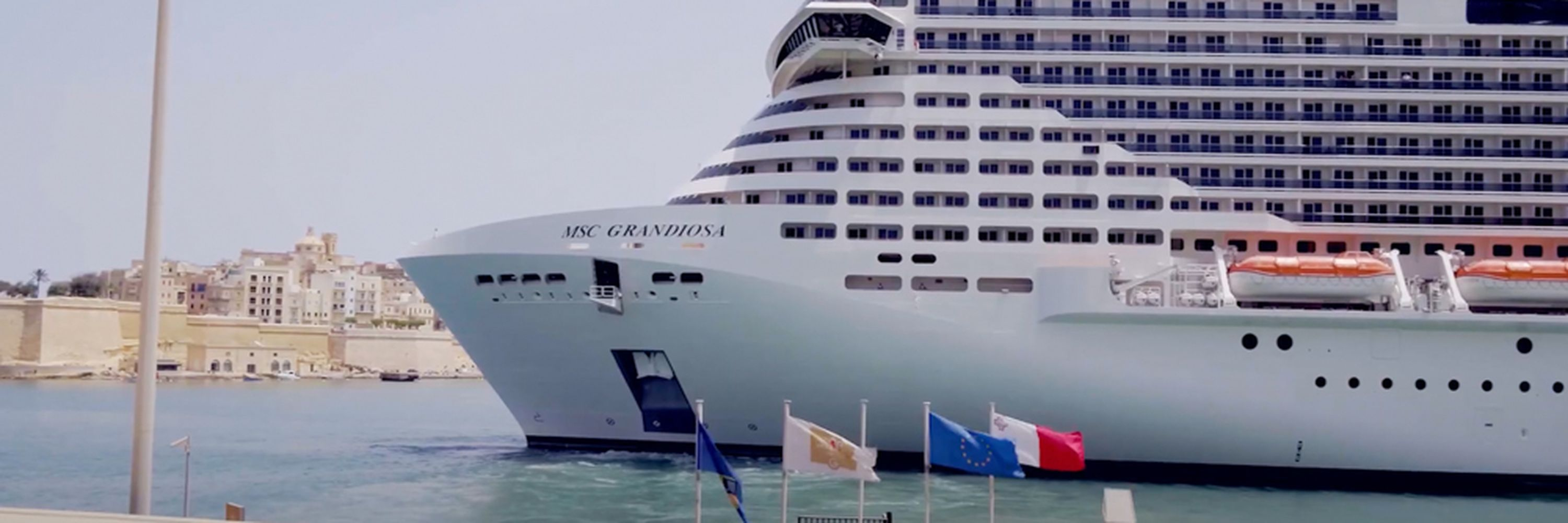 The MSC Grandiosa cruise liner at the Valletta Waterfront in motion blur's commercial
