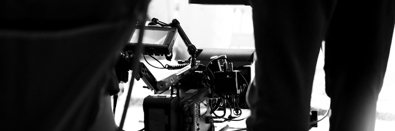 A cameraperson using an Arri Camera