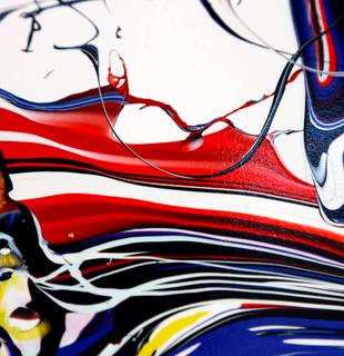detail of a print of swirling colours on a white background