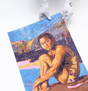 White gloves holding the corner of a colourful print of a swimmer
