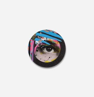 circular print of an eye surrounded by a black glitter border with three blue stripes across it