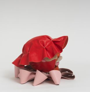 Soft sculpture of leather and cloth, Poppy by Tau Lewis