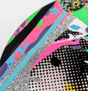 close-up of a print with silver glitter and colourful lines