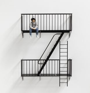Sculpture of figure sitting on miniature staircase, The Future by Elmgreen & Dragset