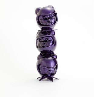 a purple sculpture of three heads in custom helmets stacked on top of each other