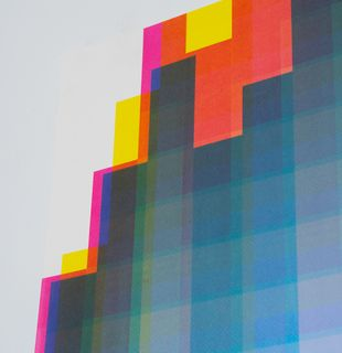 Pixelated colour spectrum with yellow and blue squares - close up