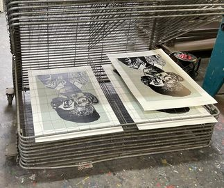 prints by artist Neo Matloga drying at the screen printing workshop