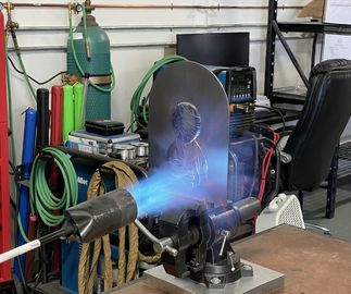 a snapshot of burning a relief plate for Slingshot (Steel Relief) by James Jean, in the metal workshop