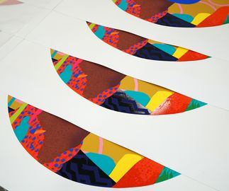 in production shot of a circular prints by Paul Insect stacked on top of each other