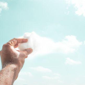 Hand clutching cloud
