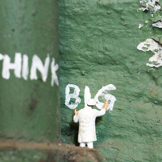 'think big' painted on a wall