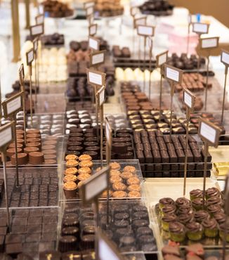 close up of chocolates being displayed at a shop