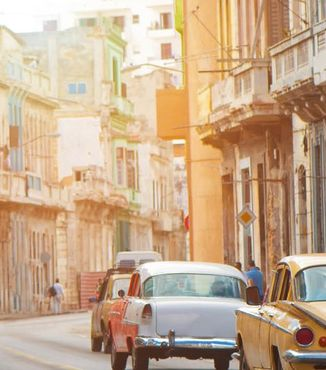 old town cars driving the street in havana cuba