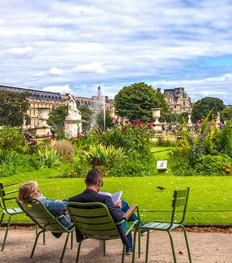 two people relaxing in chairs at tuileries garden in paris france