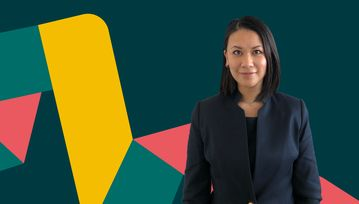 Hannah Vo, a Flex Legal paralegal of the month, looks at the camera.