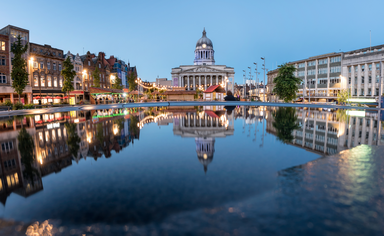 Nottingham city hall in the Old Market Square with a pool and fountain in the foreground