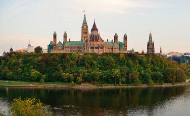 Ottawa sunset panorama over river with historical architecture