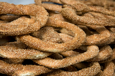 Freshly baked koulouri on a stand in Greece