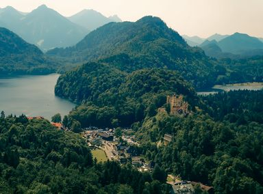 Looking down from Neuschwanstein Castle at the view of mountains and lakes