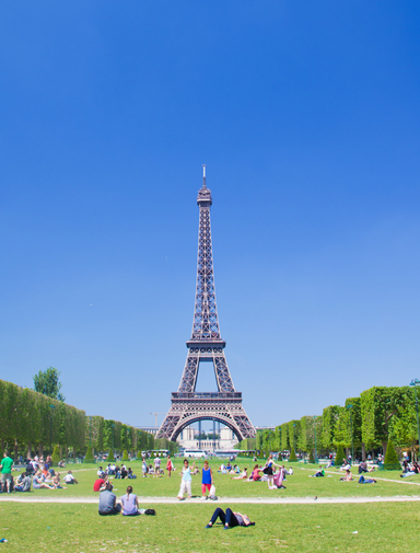 A sunny day on Champ de Mars next to the Eiffel Tower