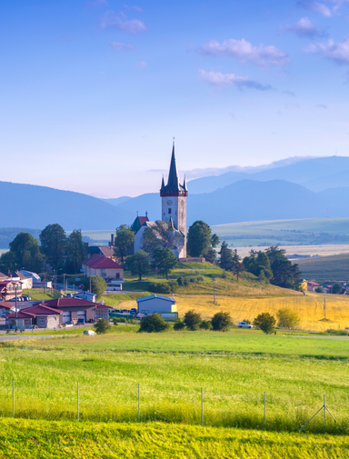 Spissky Stvrtok village in a valley in Slovakia mountains, small houses in village, rural scene