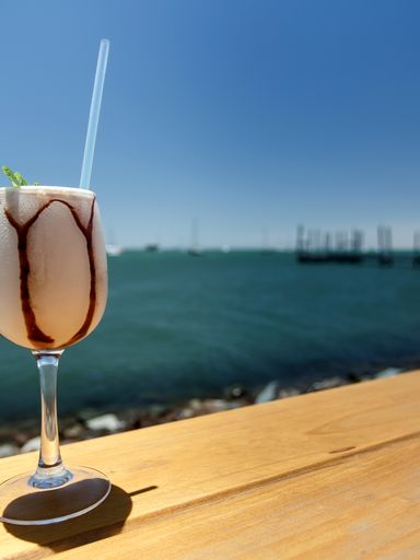 A don pedro drink at the water's edge
