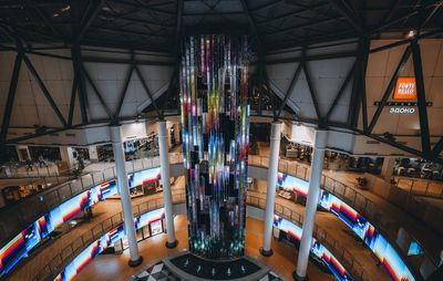 gigantic installation of a tube of pixelated colours and data