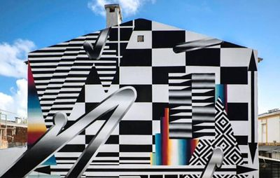external view of a building facade covered in patterns