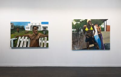 Installation view of two paintings hung alongside one another on a white wall