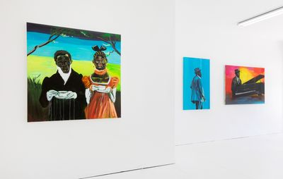 installation view of three colourful paintings hung on white walls