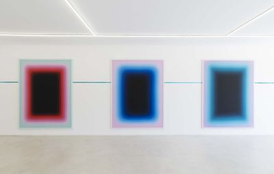 installation view of three rectangular paintings hung on a white wall
