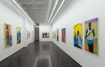 installation view of white walls with colourful portrait paintings hung
