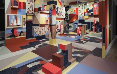 installation view of gallery space completely covered in colourful patterns and geometric shapes