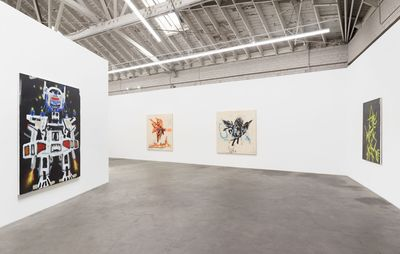 installation view of several large white walls with big square abstract paintings on them