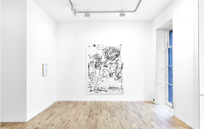 installation view of white painting with black lines hung on a white wall