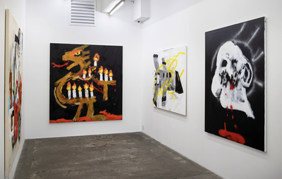 installation view of three white walls with four paintings hung on them