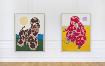 installation view of two large same-size poodle portraits hung on a white wall